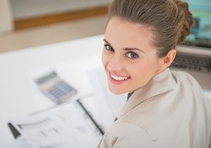 smiling business woman in office